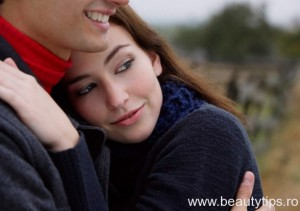 Young couple holding each other close